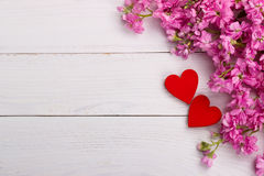 Pink flowers on wooden background Stock Photo