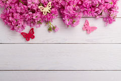 Pink flowers on wooden background Royalty Free Stock Image
