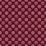 Pink flowers seamless pattern on maroon background royalty free stock photography