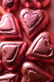 Pink foil wrapped heart shape chocolate pieces Stock Image