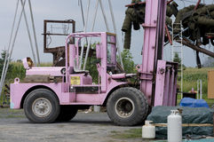 Pink Forklift. Parked outdoors on grounds of modern sculpture creation site stock image