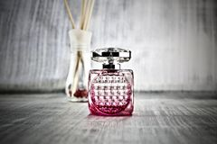 Pink fragrance in bottle. Luxury fragrance in pink square bottle Royalty Free Stock Photos