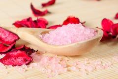Pink fragrant bath salt on spoon Stock Image