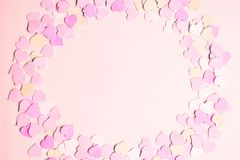 Pink frame made of small hearts for text, copy space. The concept of Valentine Day. Flat lay, top view royalty free stock photos