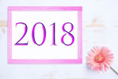 Pink frame with number 2018 and one flower Stock Photos