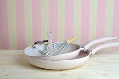 Pink Fraying Pans and Egg Tools Stock Image