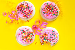 Pink frosted cookies with sprinkles Royalty Free Stock Images