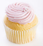 Pink frosted cupcake. Cupcake with pink frosting and flower decoration Stock Photos