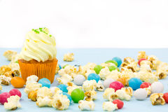 Pink frosted cupcakes on light blue background Royalty Free Stock Images