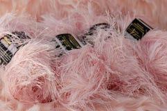 Pink fuzzy yarn. Pink yarn on pink fur stock photo