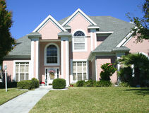 Pink gabled house Stock Photos