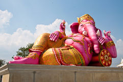 Pink ganesha statue in relaxing action Stock Photography
