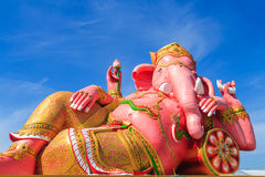 Pink ganesha statue in relaxing action Royalty Free Stock Photos