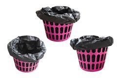 Pink garbage bin basket with empty black bag ,isolated on white background . Royalty Free Stock Photo