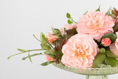 Pink garden rose arrangement in glass vase Stock Photography