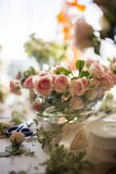 Pink garden roses in a vase in natural light Royalty Free Stock Photos