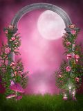 Pink garden with a stone arch Stock Images
