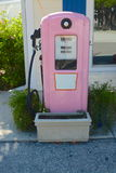 Pink gas pump. A old pink vintage fas fuelling pump Royalty Free Stock Image