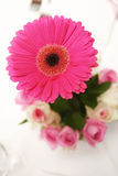 Pink Gerbera. And roses wedding flower table arrangement stock photo