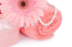 Pink gerbera and a towel Royalty Free Stock Photography