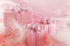 Pink gift. Three pink boxes wiht gift on the pink background stock photo