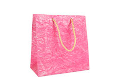 Pink gift bag isolated on white. Stock Images