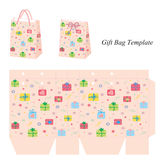 Pink gift bag with presents Royalty Free Stock Image