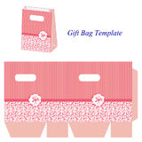 Pink gift bag with stripes and floral pattern Royalty Free Stock Photos