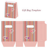Pink gift bag template with colorful stripes and hearts Royalty Free Stock Photo
