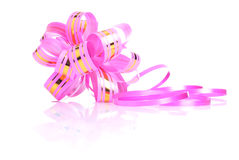 Pink gift bow with a gold ribbon isolated on white background wi Stock Photos