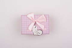 Pink gift with bow on a white background. Heart note I love You. Royalty Free Stock Image