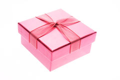 Pink gift box. A pink gift box with ribbon isolated on white stock photos