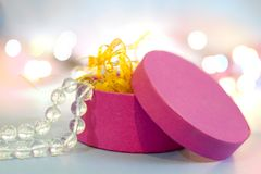 Pink gift box with beads Royalty Free Stock Photos
