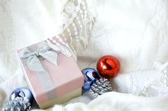 Pink gift box on clothing Royalty Free Stock Photography