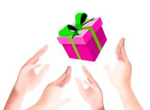 Pink Gift Box Falling Down on Human Hands Stock Photo