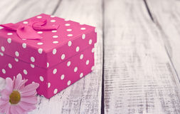 Pink gift box with flowers on rustic white wooden table. Valenti. Ne's Day and Mother's Day background. Toned image. Soft focus stock images
