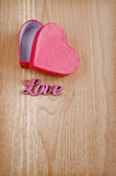 Pink gift box in heart shape Stock Photography