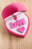 Pink gift box in heart shape Stock Photos