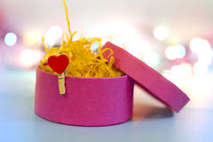 Pink gift box with heart shaped clothespeg Stock Image