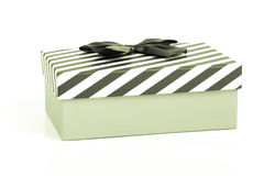 Pink gift box with a lid in a white and blue stripes and a blue. Satin bow. Toned Stock Photos
