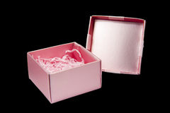 Pink gift box opened isolated. On black background Royalty Free Stock Photos