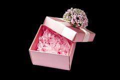 Pink gift box opened isolated. On black background Royalty Free Stock Photo