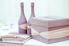 Pink gift box and paper note on wooden background Royalty Free Stock Images