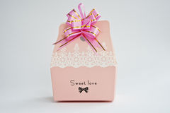 A gift box. A pink gift box with a pink flower Stock Image