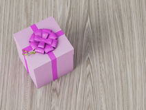 Pink gift box with pink ribbon bow. On wooden background Stock Photo