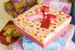 Pink gift box with pink ribbon. Close up of pink gift box with pink ribbon Stock Image
