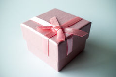 Pink gift box with pink ribbon. Close up of a pink gift box with a pink ribbon Royalty Free Stock Photo