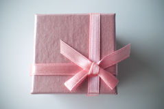 Pink gift box with pink ribbon. Close up of a pink gift box with a pink ribbon Stock Photography