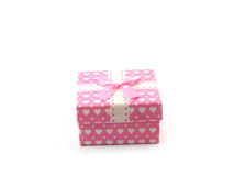 Pink gift box with pink ribbon on white background Stock Images