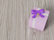 Pink gift box with purple ribbon bow Royalty Free Stock Photography